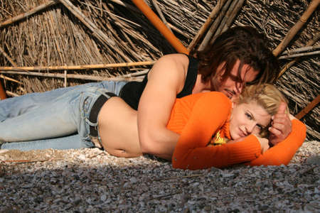 sexy couple kissing: A young blonde couple lying in a  pose Stock Photo