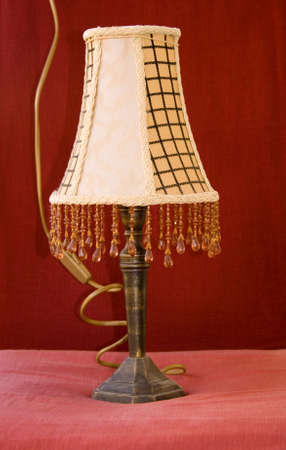 bulp: A vintage bedside lamp isolated on red background