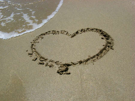 The heart sign on the sand of a beach on an island photo