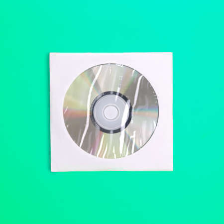 recordable: Compact disc in case view from above on colored background
