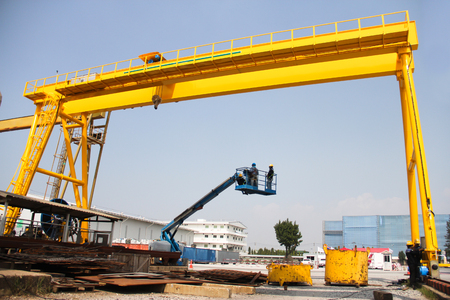 massy: Atmosphere in the construction and installation of crane  Stock Photo