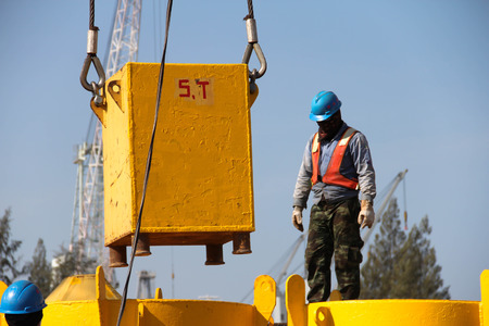 Working atmosphere in the construction, installation and safety of crane Industry. photo