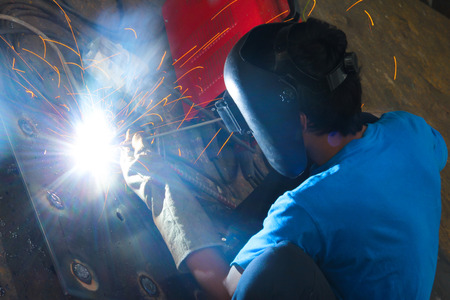 welding mask: Working atmosphere in the construction, installation and safety of crane Industry. Stock Photo