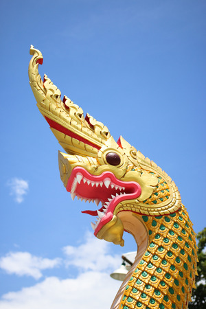 slithering: King of Nagas slithering sculpture thailand pattern on sky background.