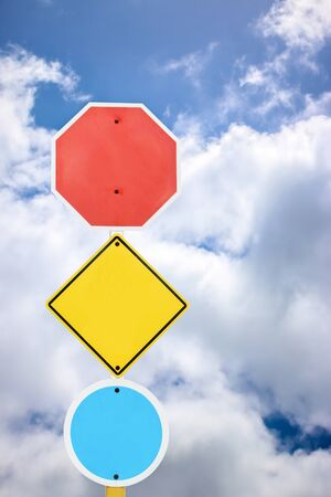 blue signage: directional signage on blue sky and cloud background. Stock Photo
