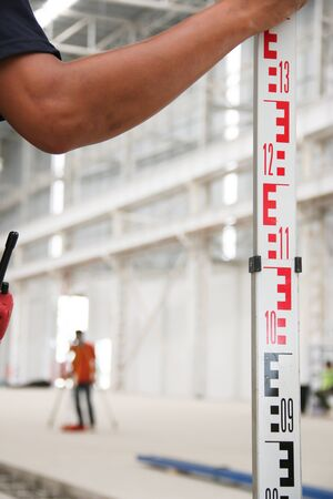 setup man: Working atmosphere in the construction, installation and safety of lifting crane industrial. Stock Photo