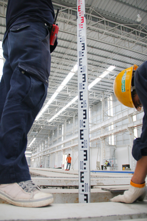 setup operator: Working atmosphere in the construction, installation and safety of lifting crane industrial. Editorial