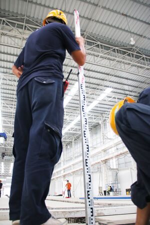 setup operator: Working atmosphere in the construction, installation and safety of lifting crane industrial. Stock Photo