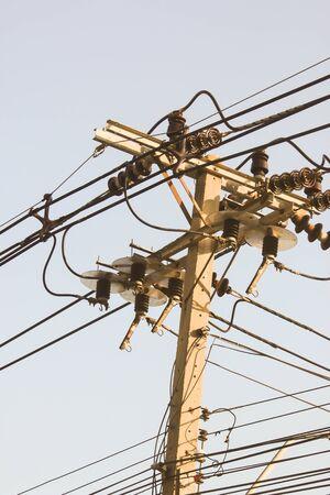 muddle: Muddle wire on electrictity post on blue sky background Stock Photo