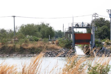 sluice: Floodgates a concrete building in the countryside. Stock Photo