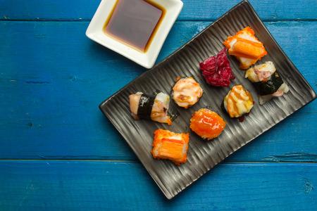 Sushi on the blue wood with mood tone Stock Photo