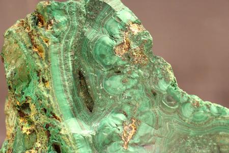 green gemstone: Malachite stone isolated (natural background) Stock Photo