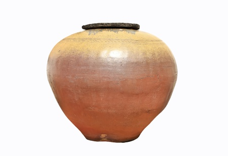 terracotta: The antique earthen jar isolated on a white background for decoration, household, etc. Stock Photo