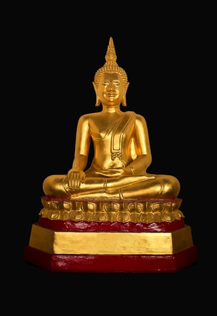 Sculpture of golden sitting posture Buddha on a black background, made of bronze. photo