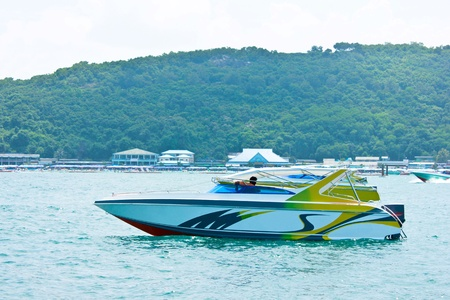 Speedboat navigating in the Gulf of Thailand Sea. photo