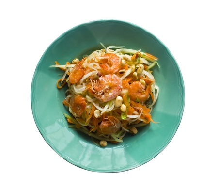 Thai papaya salad hot and spicy mixed from variety of vegetable, one of the most famous Thai's foods. photo