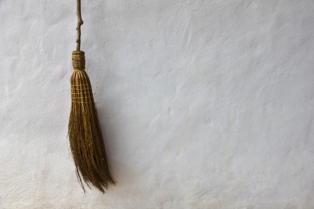 Broom on white wall in background Stock Photo - 14313086