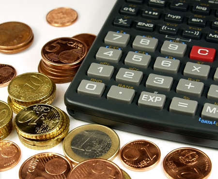 several euro coins and one calculator Stock Photo - 360464