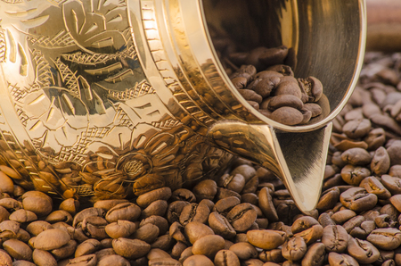 Brass coffee pot and coffee beans