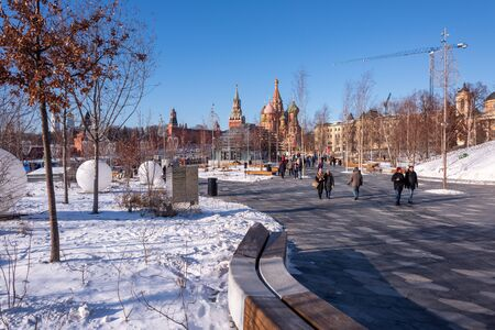Moscow, Russia - February 8, 2020: View of the Moscow Kremlin, Ivan the Great Bell-Tower, Spasskaya tower and St. Basil's Cathedral from Zaryadye Park on sunny winter day. Editöryel