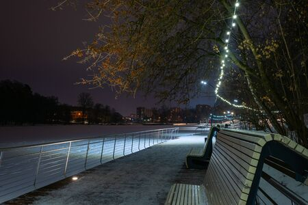 Evening in a winter park on the banks of the Pekhorka River. Russia, Moscow region, the city of Balashikha