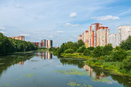 Russia, Moscow region, the city of Balashikha. View of the Pekhorka river on a summer sunny day. Stok Fotoğraf