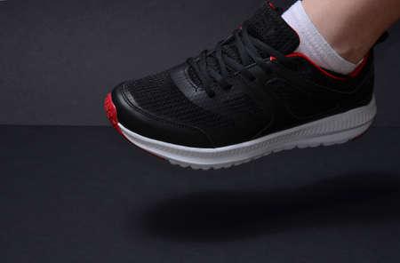 Sports sneakers on the leg of a girl. Foto de archivo