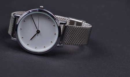 Women's watch on a black background.