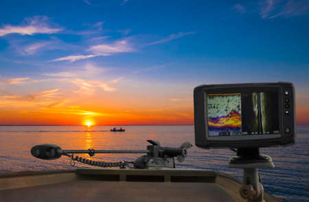 Fishfinder, echolot, fishing sonar at the boat