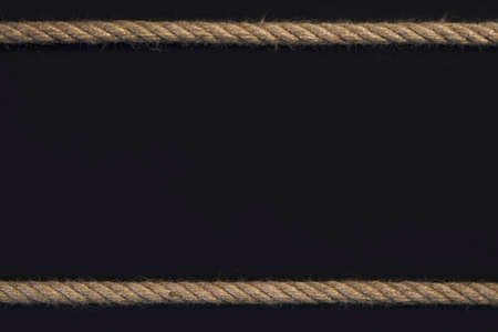 Template frame of cord rope on black background.