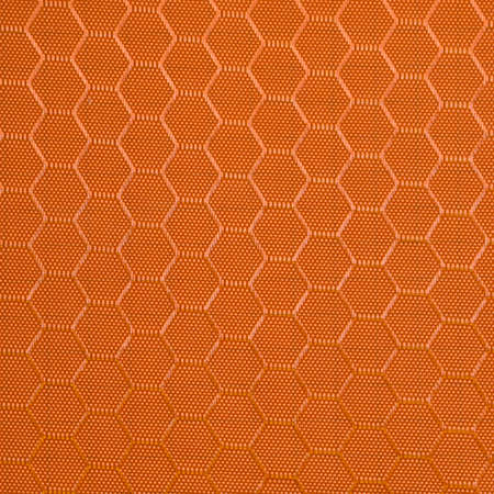 Synthetic fabric texture. Background of orange textile