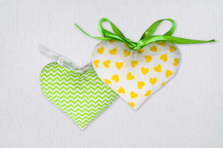 Set textile fabric toy heart on white canvas background. St. Valentines Day postcard template with copy space