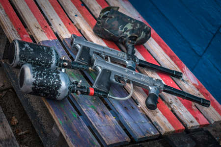 Paintball equipment. Special gun and extreme sport protective equipment mask