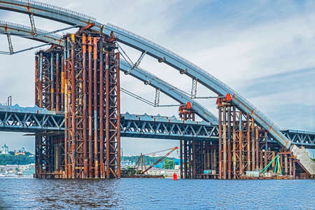 Construction of a bridge over the river. Temporary metal construct Stock Photo