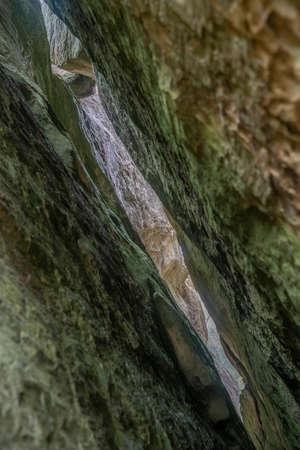 Crack split of stone rock. Ternoshorska Lada. Dovbush rocks. Carpathian, Kosiv Raion, Ivano-Frankivsk Oblast, Ukraine