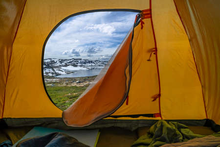 Hiking winter travel concept. View from tent - beautiful landscape of mountain nature