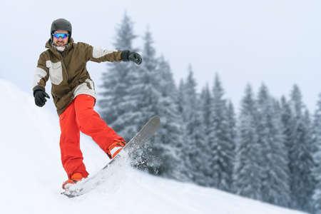 Snowboarder on snow hill. Mountain freeride snowboarding. Winter Carpathians