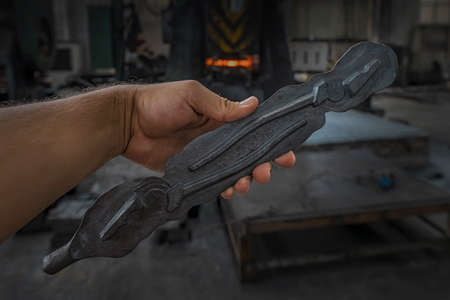 Initial blank of pliers in hand. Tool producing by forging method at metallurgical plant