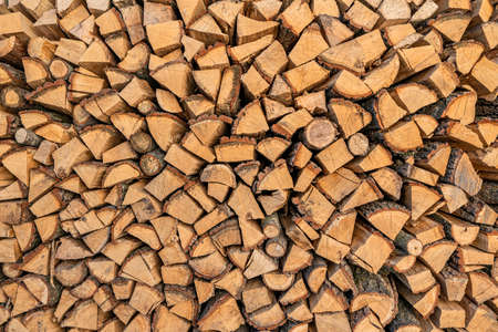 Firewood texture. Pile of dry chopped fire wood background