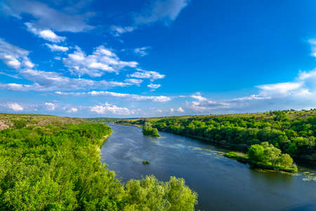 Southern Bug. Yuzhny Buh river flow through green trees. Nature landscape