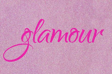 Glamor lettering word neon pink on light pink (ballet slipper) glitter texture. Shiny sparkle background 版權商用圖片