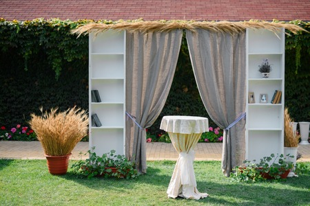 Decorative arch for wedding. Bookcase and wheat style.