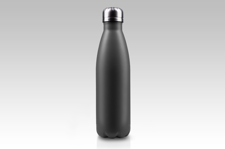 Black-matte, empty stainless  water bottle close-up isolated on white background. Studio photography.