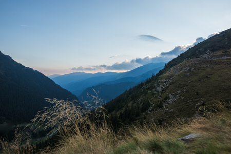 Landscape of peak Transfagarasan mountains from top at sunset