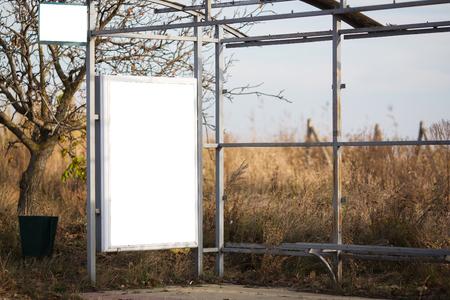 Billboard mockup on bus stop in village Banque d'images