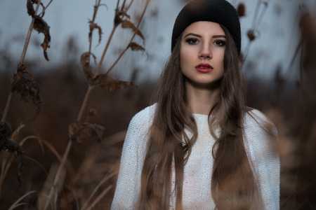 Portrait of hipster girl with black cap