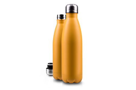 Yellow empty thermo bottle and lid, isolated on white. Stock Photo