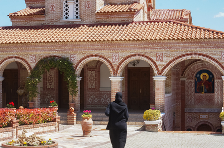 An old nun in the middle of monastery Imagens