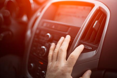 hand of man adjust heating on car Standard-Bild - 116673513