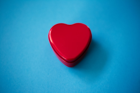 Closeup of red heart on the blue background.